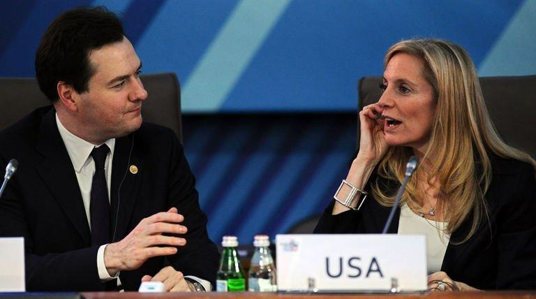 "British Finance Minister George Osborne (left) speaks with US Treasury Undersecretary Lael Brainard as they attend a meeting of G20 finance ministers and central bank governors' deputies in Moscow, on February 16, 2013. G20 finance ministers have moved to calm fears of looming ""economic warfare"" on the currency markets"