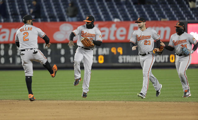 From left to right, Baltimore Orioles' Jonathan Villar, Cedric Mullins, Joey Rickard and Dwight Smith Jr. celebrate after a baseball game against the New York Yankees at Yankee Stadium, Sunday, March 31, 2019, in New York. (AP Photo/Seth Wenig)