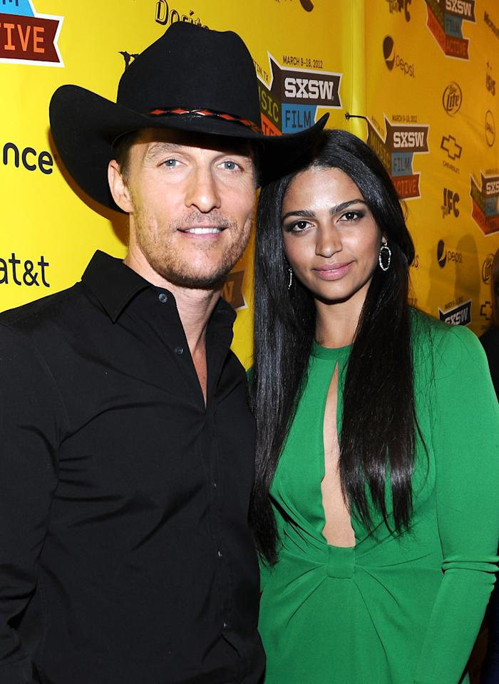 "AUSTIN, TX - MARCH 10:  Actor Matthew McConaughey (L) and designer Camila Alves arrive at the U.S. Premiere of ""Killer Joe"" during the 2012 SXSW Music, Film + Interactive Festival at the Paramount Theatre on March 10, 2012 in Austin, Texas.  (Photo by Michael Buckner/Getty Images for SXSW)"