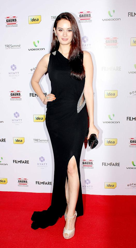 Evelyn Sharma poses pretty in her mid slit black dress.