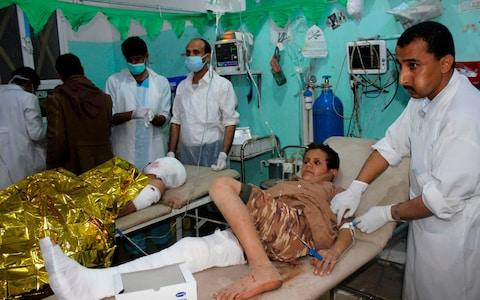 <span>An injured Yemeni child receives medical aid at an emergency room in the Saada province early on November 20, 2018, following a reported air strike</span> <span>Credit: AFP </span>