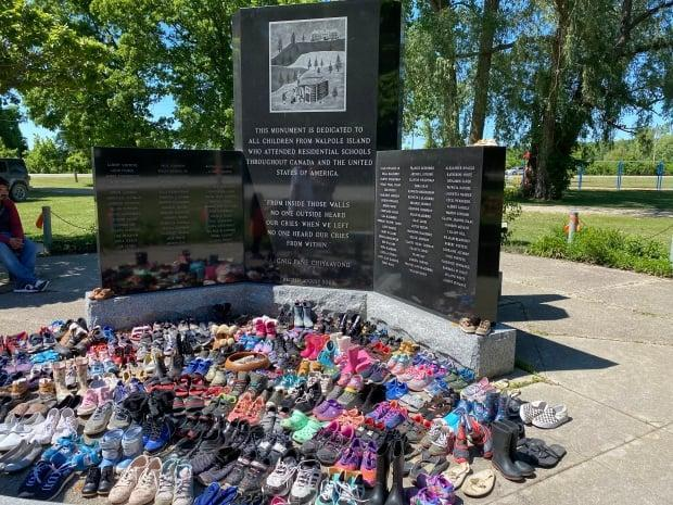 More than 200 pairs of children's shoes were placed at the Walpole Island residential school monument in southwestern Ontario to honour the lost children at the former B.C. residential school. (Sumbitted by Derek Sands - image credit)
