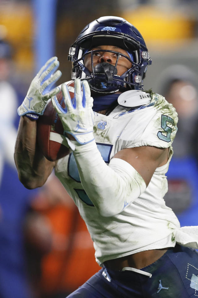 North Carolina wide receiver Dazz Newsome makes a catch for a touchdown against Pittsburgh during the second half of an NCAA college football game Thursday, Nov. 14, 2019, in Pittsburgh. Pittsburgh won 34-27 in overtime. (AP Photo/Keith Srakocic)