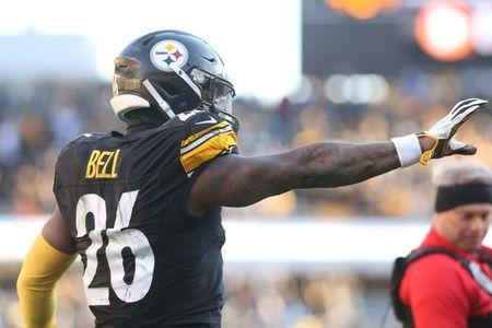 Jan 14, 2018; Pittsburgh, PA, USA; Pittsburgh Steelers running back Le'Veon Bell (26) celebrates after catching a touchdown pass against the Jacksonville Jaguars during the third quarter in the AFC Divisional Playoff game at Heinz Field. Geoff Burke-USA TODAY Sports