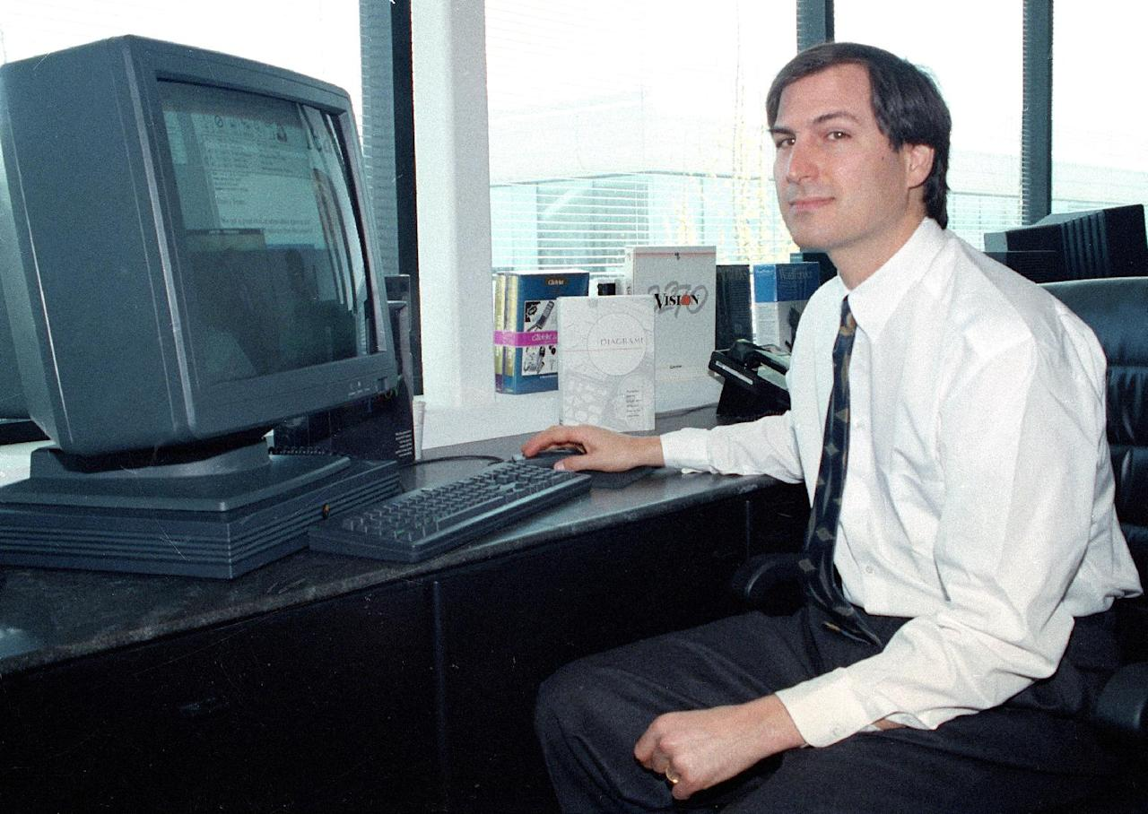 FILE - In this April 4, 1991, file photo, Steve Jobs, of NeXT Computer Inc., poses with his NeXTstation color computer for the press at the NeXT facility in Redwood City, Calif. Apple on Wednesday, Oct. 5, 2011 said Jobs has died. He was 56. (AP Photo/Ben Margot, File)