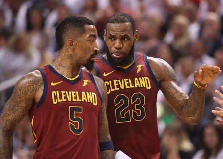 May 3, 2018; Toronto, Ontario, CAN; Cleveland Cavaliers forward LeBron James (23) talks to forward J.R. Smith (5) against the Toronto Raptors in game two of the second round of the 2018 NBA Playoffs at Air Canada Centre. The Cavaliers beat the Raptors 128-110. Mandatory Credit: Tom Szczerbowski-USA TODAY Sports
