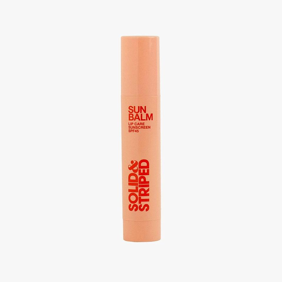 """Don't forget—your lips need be sun safe too! To protect the skin and collagen of the lips, swipe on this SPF 45 balm, which not only boasts moisturizing cactus flower, cell turnover-boosting Tibetan ginseng, but peptides that work to make lips naturally fuller. $14, SOLID & STRIPED. <a href=""""https://shop-links.co/1707067660614206862"""" rel=""""nofollow noopener"""" target=""""_blank"""" data-ylk=""""slk:Get it now!"""" class=""""link rapid-noclick-resp"""">Get it now!</a>"""