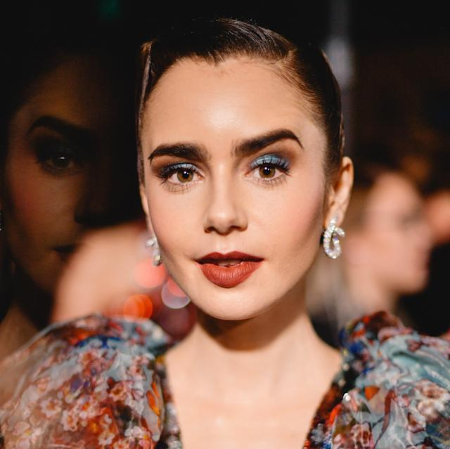 "Makeup artist Fiona Stiles proves bright blue looks incredible with neutral, earthy colors on <a href=""https://www.allure.com/topic/lily-collins?mbid=synd_yahoo_rss"" rel=""nofollow noopener"" target=""_blank"" data-ylk=""slk:Lily Collins"" class=""link rapid-noclick-resp"">Lily Collins</a>. ""Electric teal and milk chocolate eyes 👀 + burnt rose lips 👄 + petal pink 🌸 cheeks = a little piece of H E A V E N,"" she <a href=""https://www.instagram.com/p/BsSC__Vl2l-/"" rel=""nofollow noopener"" target=""_blank"" data-ylk=""slk:wrote on Instagram"" class=""link rapid-noclick-resp"">wrote on Instagram</a>, making her makeup perfectly match the shades in the gown that Collins wore to the Art of Elysium event."