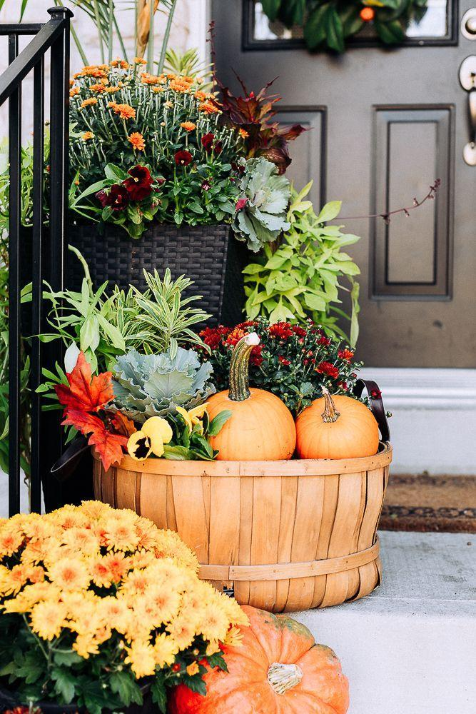 """<p>A bushel basket provides the perfect nod towards a beloved fall activity, plus adds some dimension to your decor. </p><p><a class=""""link rapid-noclick-resp"""" href=""""https://www.craftberrybush.com/2018/09/front-porch-fall-decor-ideas.html"""" rel=""""nofollow noopener"""" target=""""_blank"""" data-ylk=""""slk:GET THE TUTORIAL"""">GET THE TUTORIAL</a></p>"""
