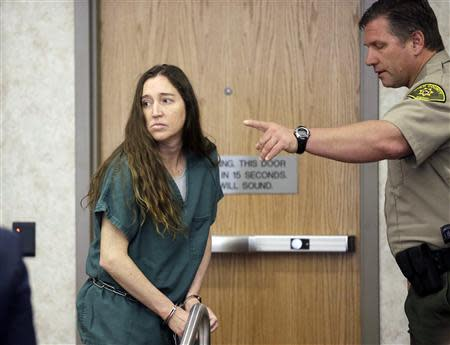 Megan Huntsman, accused of killing six of her babies and storing their bodies in her garage, appears in court in Provo