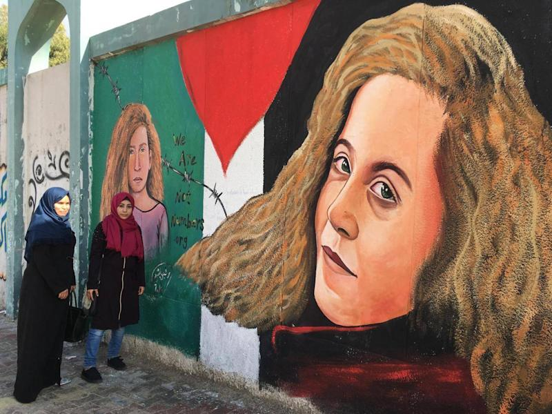 A mural by artist Rafiq al Sharif in Gaza of Palestinian teenager, Ahed Tamimi, who was jailed for slapping a soldier in the West Bank (Sarah Helm)