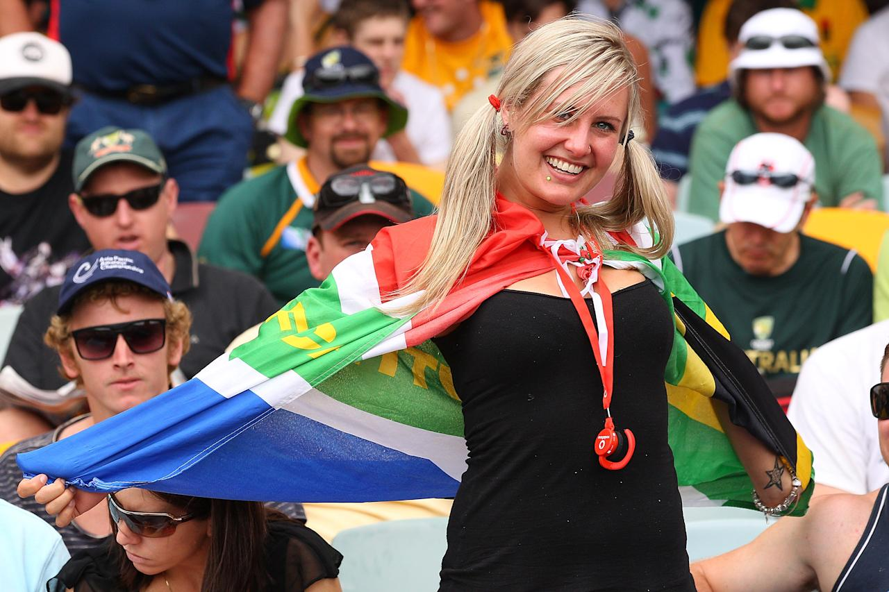 BRISBANE, AUSTRALIA - NOVEMBER 11:  South Afrcia fan cheers during day three of the First Test match between Australia and South Africa at The Gabba on November 11, 2012 in Brisbane, Australia.  (Photo by Chris Hyde/Getty Images)