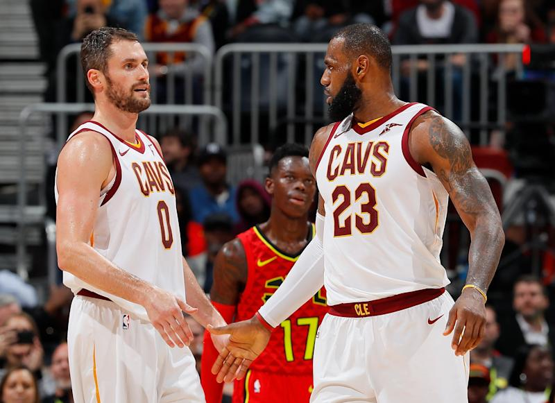ATLANTA, GA - NOVEMBER 30: LeBron James #23 of the Cleveland Cavaliers reacts with Kevin Love #0 after drawing a foul against the Atlanta Hawks at Philips Arena on November 30, 2017 in Atlanta, Georgia. NOTE TO USER: User expressly acknowledges and agrees that, by downloading and or using this photograph, User is consenting to the terms and conditions of the Getty Images License Agreement. (Photo by Kevin C. Cox/Getty Images)