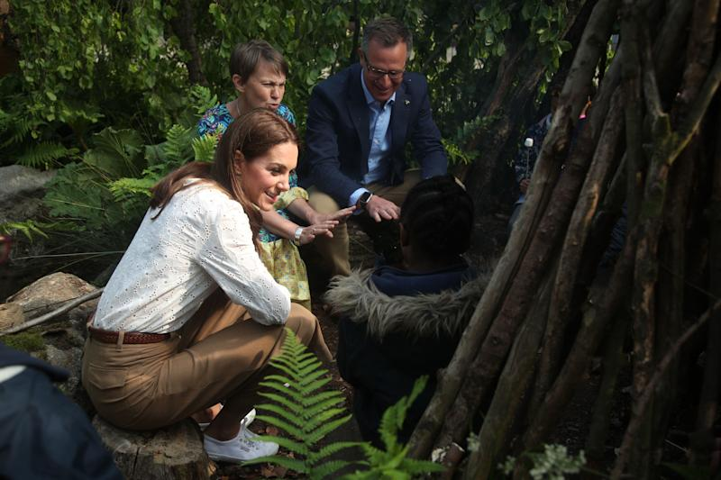 Catherine, Duchess of Cambridge with Andrée Davies and Adam White during a visit to her garden at the RHS Chelsea Flower Show at the Royal Hospital Chelsea on May 20, 3019 in London, United Kingdom. (Photo: Yui Mok 'Äì WPA Pool/Getty Images)