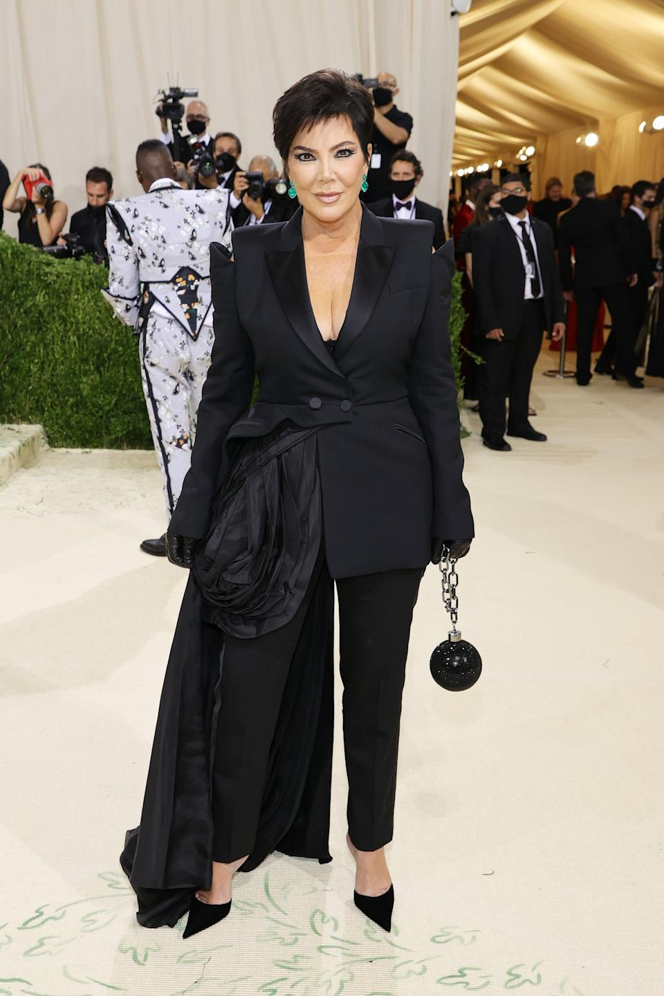 <p>Wearing a Tom Ford suit with a Judith Leiber clutch and Lorraine Schwartz jewels. </p>