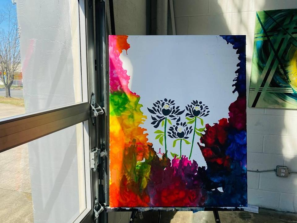 "Arelys Ripoll says her art represents her mood at the time. If her mood is dark, she adds a happy or positive element, like the flowers that bloom in ""Chaos"" (above)."