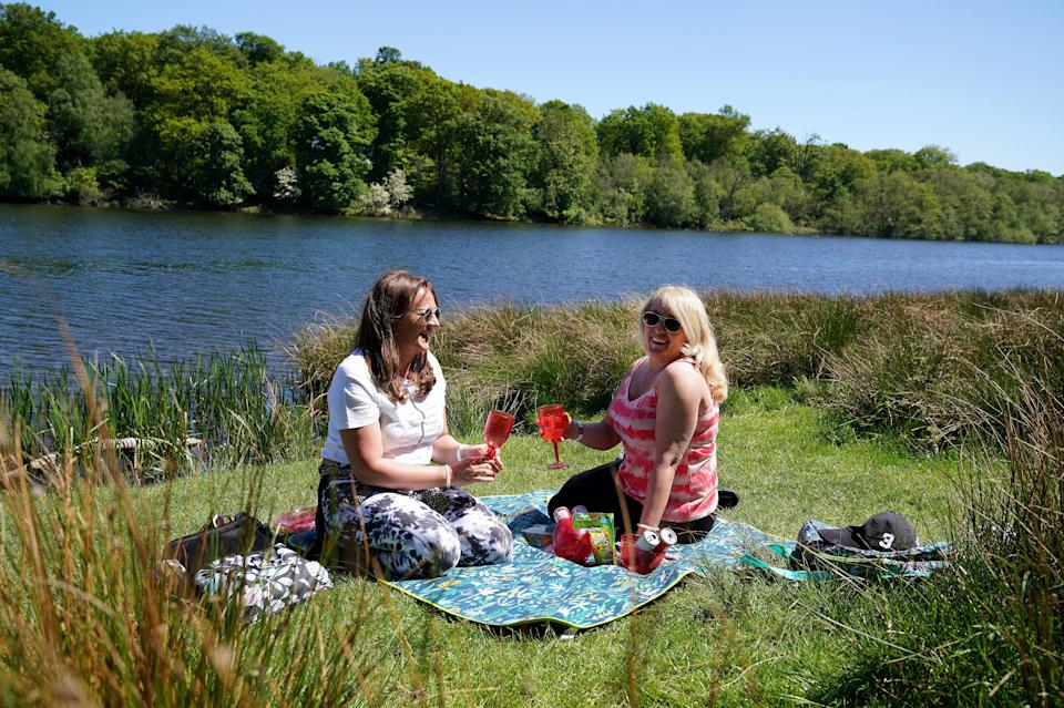 <p>People enjoy the sunshine in Tatton Park, Knutsford, Cheshire</p> (PA Wire)