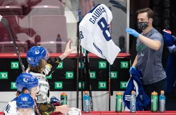 The Vancouver Canucks traded Adam Gaudette to Chicago for forward Matthew Highmore. Gaudette was the first Canucks player to be diagnosed with COVID-19. (Darryl Dyck/THE CANADIAN PRESS - image credit)