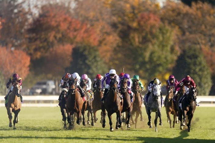 Pierre-Charles Boudot, center front in purple silks, rides Order of Australia to win the Breeders' Cup Mile horse race at Keeneland Race Course, in Lexington, Ky., Saturday, Nov. 7, 2020. (AP Photo/Mark Humphrey)