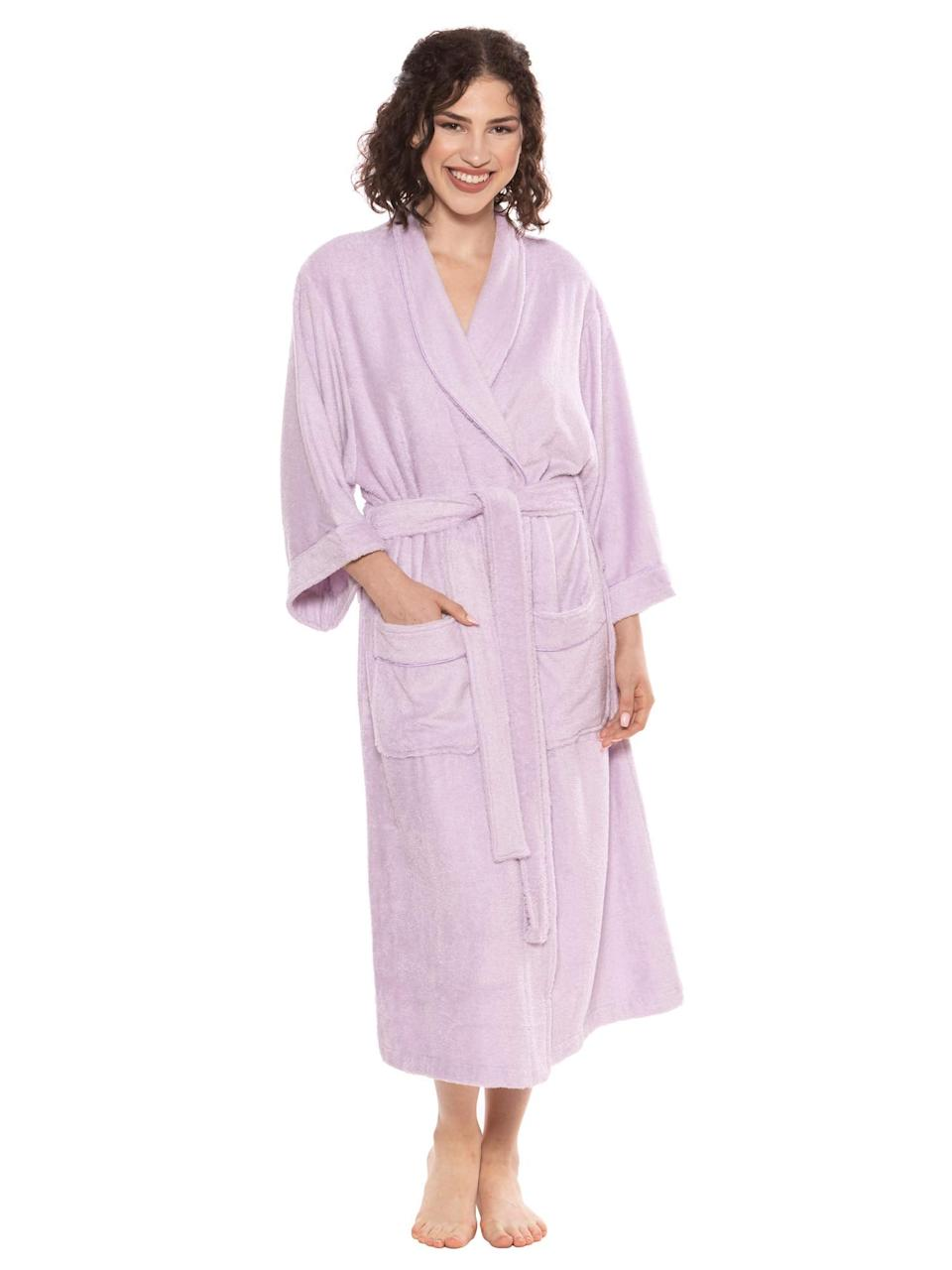 """<h3><a href=""""https://amzn.to/2Q1oqZR"""" rel=""""nofollow noopener"""" target=""""_blank"""" data-ylk=""""slk:Luxury Bamboo-Cotton Bathrobe"""" class=""""link rapid-noclick-resp"""">Luxury Bamboo-Cotton Bathrobe</a></h3><br>Yes, you <em>can</em> get your hands on a luxe-looking and feeling bamboo-cotton blend robe for under $50 — and this top-rated Amazon-style in a calming lavender hue proves it. <br><br>One cozied up customer praised: """"This is a beautiful, spa-quality terry robe. I have been searching for a while for a large comfortable terry robe to throw on right after a shower-no need for a towel. But they are VERY pricey. I was browsing one day and came across this robe. At the price I thought it couldn't be that good, but what the heck, so I gave it a try. This has to be one of the nicest terry robes I have ever owned and it cost less than a quarter of what I have spent. It is soft and absorbent. It is warm and snuggly and heavyweight. This is an excellent buy."""" <br><br><br><br><strong>TexereSilk</strong> Luxury Bamboo Viscose Robe, $, available at <a href=""""https://amzn.to/2Q1oqZR"""" rel=""""nofollow noopener"""" target=""""_blank"""" data-ylk=""""slk:Amazon"""" class=""""link rapid-noclick-resp"""">Amazon</a>"""