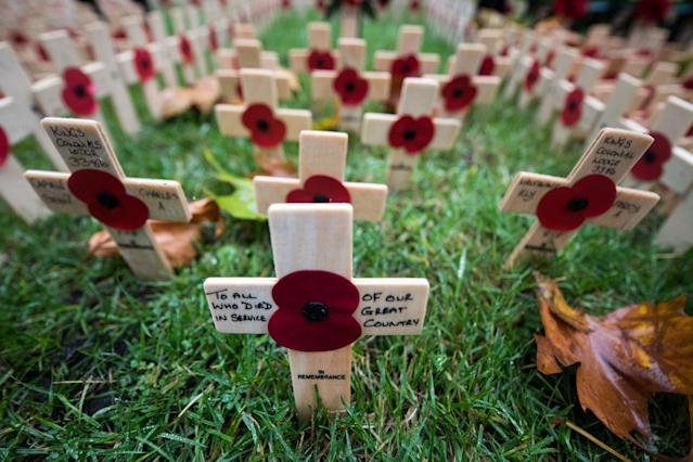 <p>Messages are written on Crosses of Remembrance placed in the Field of Remembrance at Westminster Abbey in central London on Nov. 11, 2017, the Armistice Day. On Armistice Day, many Britons wear a paper red poppy — symbolizing the poppies which grew on French and Belgian battlefields during World War I — in their lapels. (Photo: Chris J. Ratcliffe/AFP/Getty Images) </p>