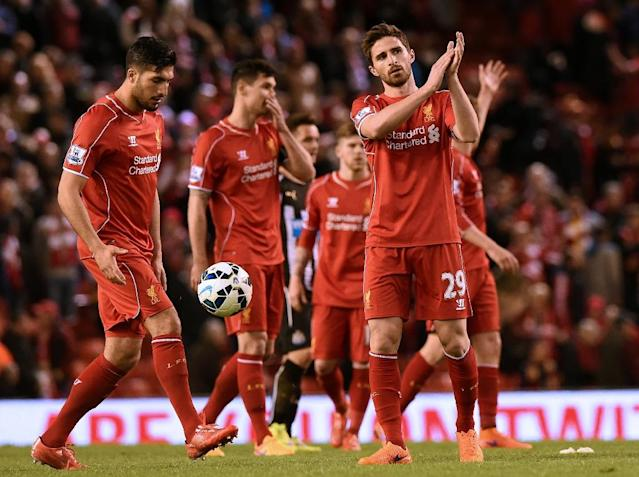 Liverpool's Fabio Borini (R) applauds supporters at the end of the Premier League match against Newcastle United at Anfield on April 13, 2015 (AFP Photo/Paul Ellis)