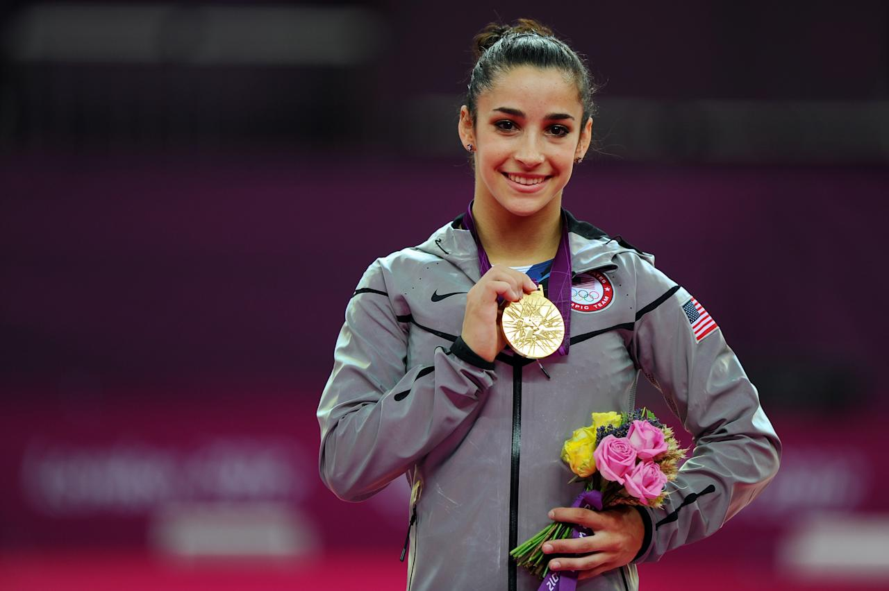 Gold medalist Alexandra Raisman of the United States poses on the podium during the medal ceremony for the Artistic Gymnastics Women's Floor Exercise final on Day 11 of the London 2012 Olympic Games at North Greenwich Arena on August 7, 2012 in London, England.  (Photo by Michael Regan/Getty Images)