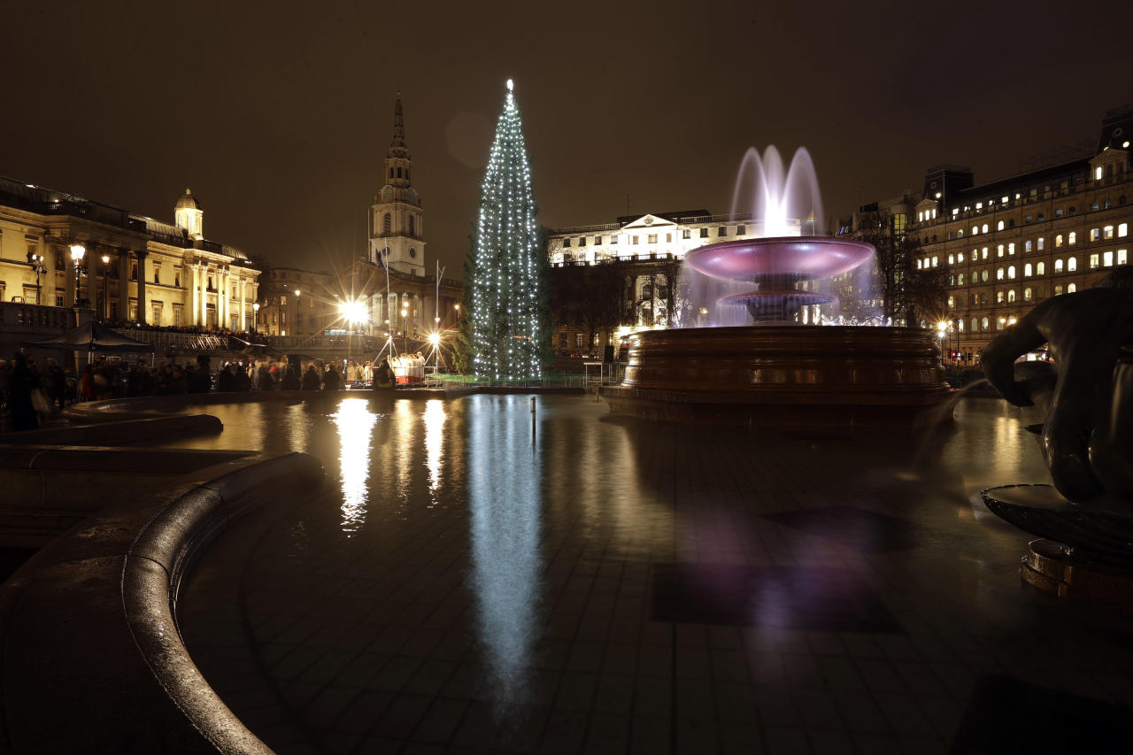 <p>The Norwegian Christmas tree is reflected in the water of a fountain after its lights were turned on in a ceremony in Trafalgar Square, London, Thursday, Dec. 6, 2018. The Christmas tree is an annual gift from the city of Oslo to the people of Britain as a token of thanks for British support during their years of occupation in World War II. (AP Photo/Matt Dunham) </p>