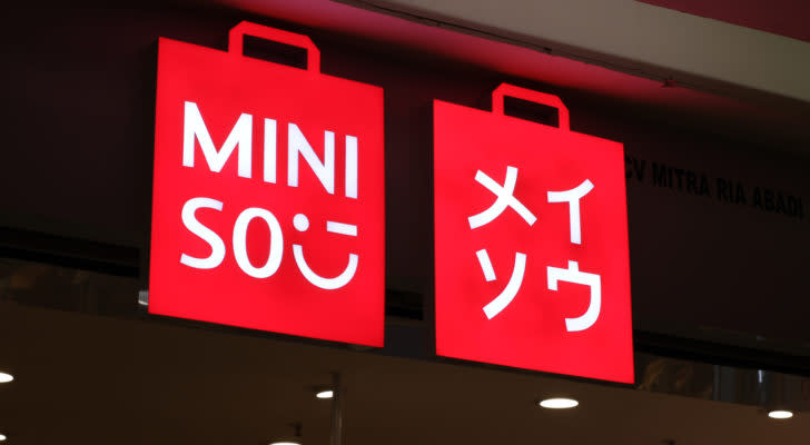 red Miniso (MNSO) sign glowing at night