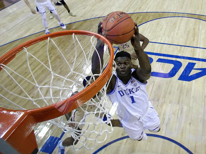 Couple uses Zion Williamson for dunking baby gender reveal