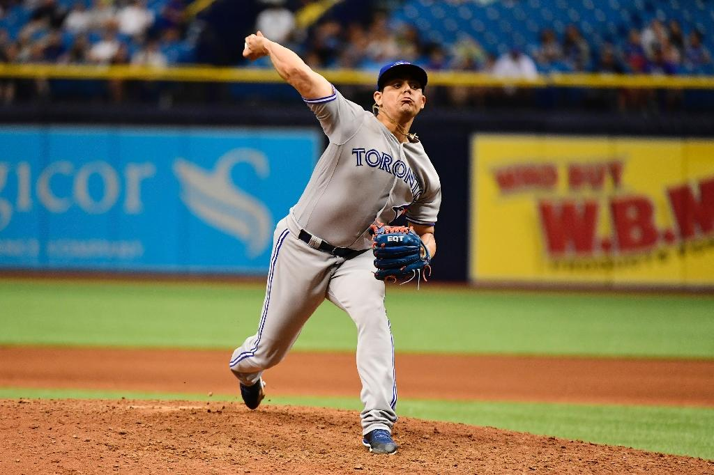 (FILES) In this file photo taken on May 6, 2018 Roberto Osuna #54 of the Toronto Blue Jays pitches. Major League Baseball warned that the legalization of sports betting could have 'profound effects' on the game (AFP Photo/Julio Cesar AGUILAR)