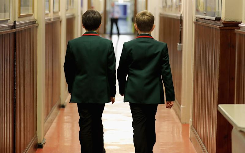 Schoolboys make their way to class at Altrincham Grammar School for Boys  - Credit: Christopher Furlong/Getty Images