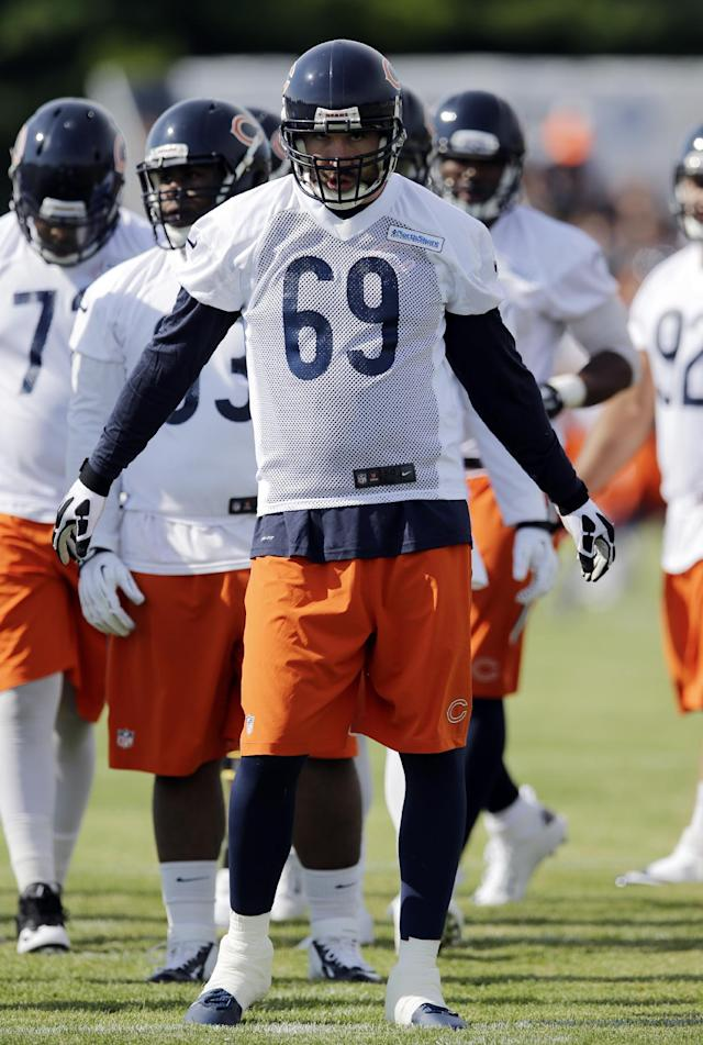 Chicago Bears defensive end Jared Allen (69) stretches on the field during NFL football training camp at Olivet Nazarene University on Friday, July 25, 2014., in Bourbonnais, Ill. (AP Photo/Nam Y. Huh)