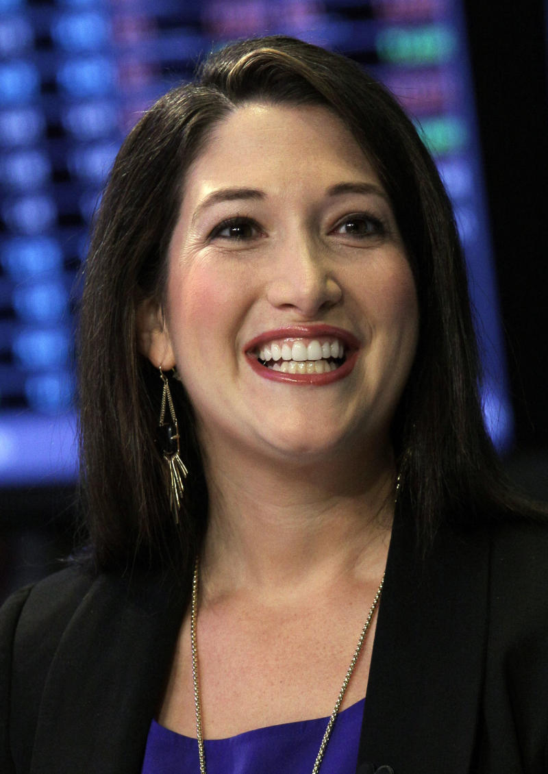 "FILE - This Oct. 15, 2012 file photo shows Randi Zuckerberg, sister of Facebook founder Mark Zuckerberg, at the New York Stock Exchange. HarperCollins announced Wednesday that Randi Zuckerberg plans a memoir and a children's book. The social media executive and entrepreneur left Facebook in 2011. Her memoir, ""Dot Complicated,"" is scheduled for release Nov. 5. It will combine personal and professional insights for the digital age, from her years as Facebook's marketing director to becoming a mother in 2011. (AP Photo/Richard Drew, file)"