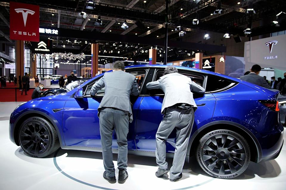 Visitors check an electric vehicle (EV) displayed at the Tesla booth during a media day for the Auto Shanghai show in Shanghai on April 20, 2021. Photo: Reuters