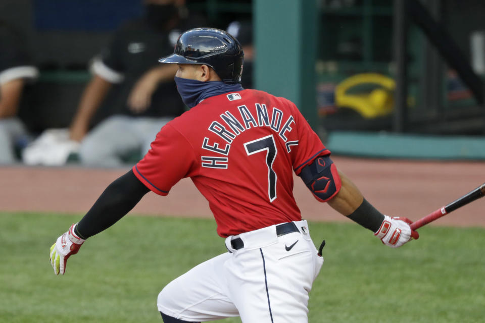 Cleveland Indians' Cesar Hernandez watches his single during the sixth inning of the team's baseball game against the Chicago White Sox, Wednesday, July 29, 2020, in Cleveland. (AP Photo/Tony Dejak)