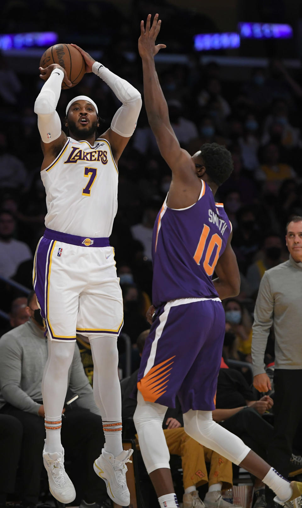 Los Angeles Lakers forward Carmelo Anthony (7) shoots the ball over Phoenix Suns forward Jalen Smith (10) in the second half of a preseason NBA basketball game in Los Angeles, Sunday, Oct. 10, 2021. (AP Photo/John McCoy)