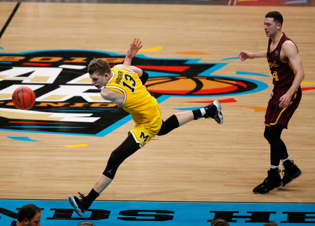 Michigan's Moritz Wagner (13) chases the loose ball during the second half in the semifinals of the Final Four NCAA college basketball tournament against Loyola-Chicago, Saturday, March 31, 2018, in San Antonio. (AP Photo/Brynn Anderson)