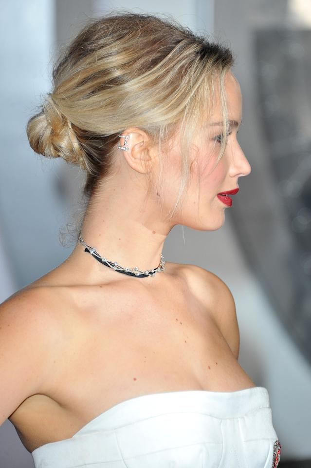 <p>A perfect bun, fixed at the nape of the neck, was a great pairing with the balletic Dior white dress Jennifer wore to the premiere of 'Passengers'. [Photo: Getty] </p>