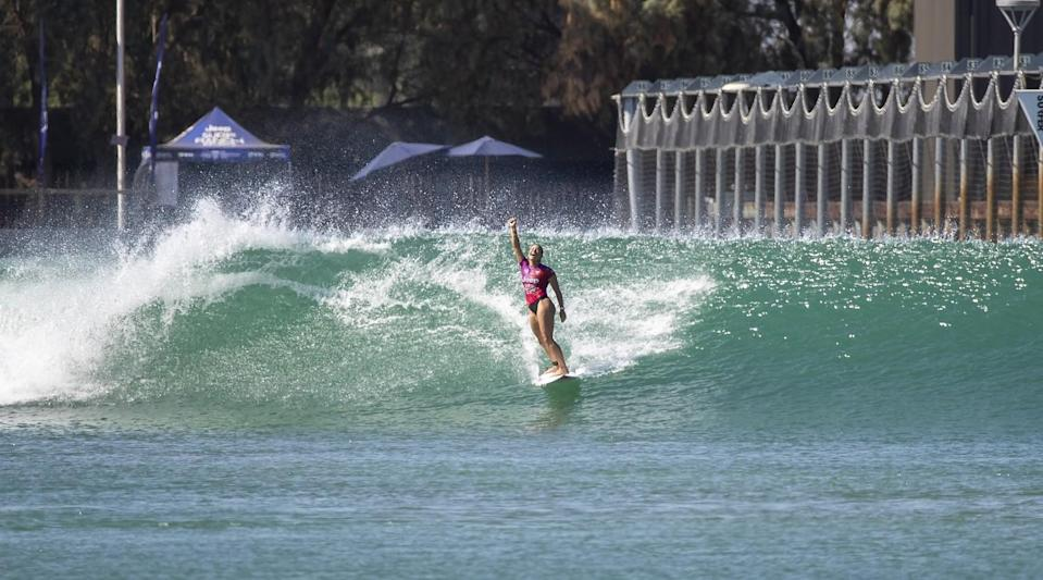Johanne Defay, of France, celebrates defeating reigning Surf Ranch champion and four-time world champion Carissa Moore