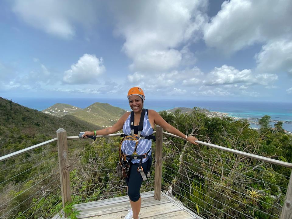 A woman stands on deck at Rainforest Adventure in St. Martin.
