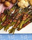 """<p>Everyone knows that the best way to serve veggies is with bacon. So these asparagus bundles are sure to be a hit at Easter!</p><p><a href=""""https://www.thepioneerwoman.com/food-cooking/recipes/a35565767/bacon-wrapped-asparagus-bundles-recipe/"""" rel=""""nofollow noopener"""" target=""""_blank"""" data-ylk=""""slk:Get the recipe."""" class=""""link rapid-noclick-resp""""><strong>Get the recipe.</strong></a></p><p><a class=""""link rapid-noclick-resp"""" href=""""https://go.redirectingat.com?id=74968X1596630&url=https%3A%2F%2Fwww.walmart.com%2Fsearch%2F%3Fquery%3Dpioneer%2Bwoman%2Bcookware&sref=https%3A%2F%2Fwww.thepioneerwoman.com%2Ffood-cooking%2Fmeals-menus%2Fg35585877%2Feaster-recipes%2F"""" rel=""""nofollow noopener"""" target=""""_blank"""" data-ylk=""""slk:SHOP COOKWARE"""">SHOP COOKWARE</a></p>"""