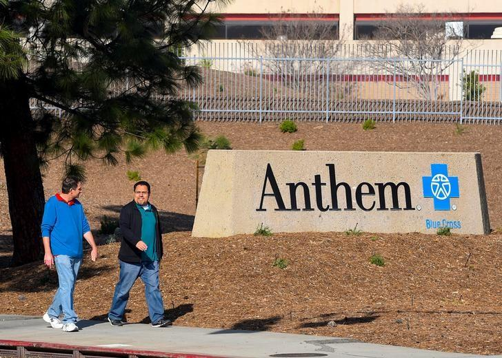 People walk past the office building of health insurer Anthem in Los Angeles, California