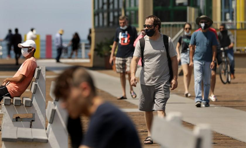 SANTA MONICA-CA-JULY 21, 2020: People visit the Santa Monica Pier on Tuesday, July 21, 2020. California has again reported its highest number of coronavirus cases in a single day Monday. (Christina House / Los Angeles Times)