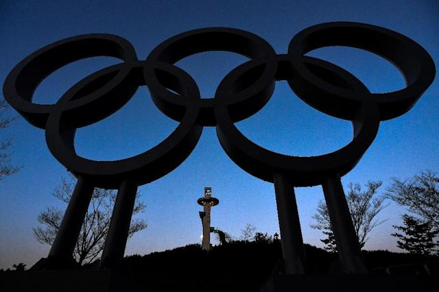The ski jump tower is seen behind the the Olympic rings ahead of the Pyeongchang 2018 Winter Olympic Games in Pyeongchang (AFP Photo/Kirill KUDRYAVTSEV)