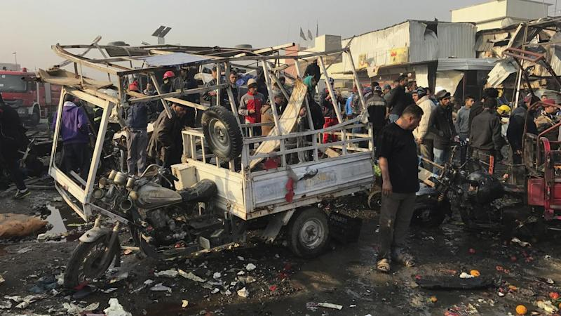 Two suicide bomb attacks, one claimed by IS, have killed 20 and left more than 50 injured in Baghdad