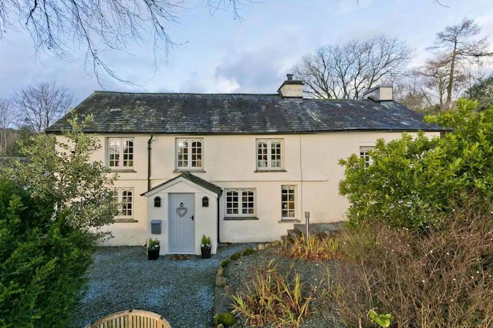"""<p>Sitting close to the pretty village of Hawkshead, this period rental retains its original Lakeland character and charm while providing modern style and comfort. Exposed beams, solid wood beds and window seats are part of the wonderful interior space, while the gardens are a mix of sloping lawn and patio with furniture for you to relax outside.</p><p><strong>Sleeps:</strong> 8</p><p><strong>Price per night:</strong> £391</p><p><a class=""""link rapid-noclick-resp"""" href=""""https://airbnb.pvxt.net/jWRVK6"""" rel=""""nofollow noopener"""" target=""""_blank"""" data-ylk=""""slk:SEE INSIDE"""">SEE INSIDE</a></p><p><strong>We want to help you stay inspired. Sign up for the latest travel tales and to hear about our favourite financially protected escapes and bucket list adventures.</strong></p><p><a class=""""link rapid-noclick-resp"""" href=""""https://hearst.emsecure.net/optiext/optiextension.dll?ID=Mf2Mbm2t6kFIB2qaqu7QV5QAIooPPMrcO%2BU6d2SmsL4zpSgeyQIbzx5P9sbmxMKLhPooFIrsXaC2MY"""" rel=""""nofollow noopener"""" target=""""_blank"""" data-ylk=""""slk:SIGN UP"""">SIGN UP</a></p>"""