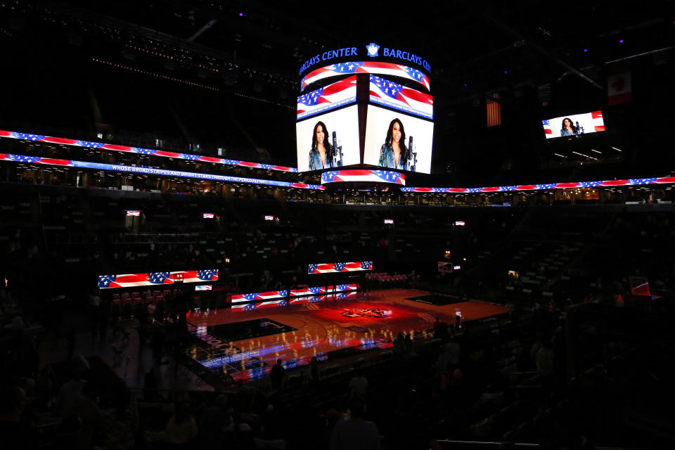 The national anthem is sung before an empty court before the Indiana Fever take on the New York Liberty in a WNBA basketball game, Friday, May 14, 2021, in New York. (AP Photo/Adam Hunger)