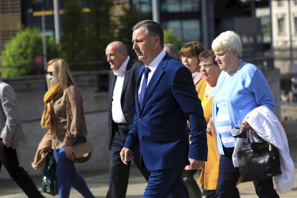 Son John Taggart and other family members of Daniel who was shot, arrive for the inquest into the Ballymurphy shooting, in Belfast, Northern Ireland, Tuesday May 11, 2021. The findings of the inquest into the deaths of 10 people during an army operation in August 1971 is due to be published on Tuesday. (AP Photo/Peter Morrison)