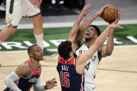 Milwaukee Bucks' Giannis Antetokounmpo drives to the basket against Washington Wizards' Anthony Gill and Russell Westbrook during the second half of an NBA basketball game Wednesday, May 5, 2021, in Milwaukee. (AP Photo/Aaron Gash)